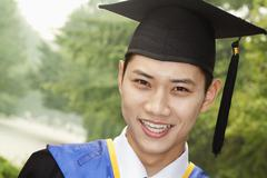 Young Man Graduating From University, Close-Up Portrait - stock photo