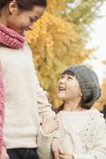 Mother and Daughter Enjoying a Park in Autumn Stock Photos