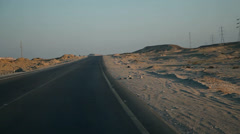 Driving on a deserted road in sunset Stock Footage