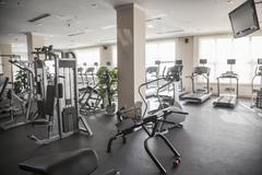 Large, bright gym with workout equipment. Kuvituskuvat