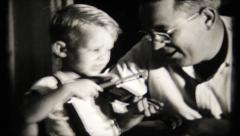 531 - fiddle playing while dad sings  - vintage film home movie Stock Footage