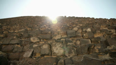 Pyramid huge bricks with sun shining above Stock Footage