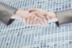 Close up of two business people shaking hands by Chinas world trade center in - stock photo