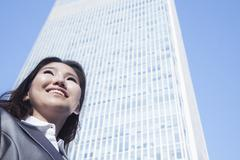 Portrait of young businesswoman by Chinas world trade center building in Beijing Stock Photos