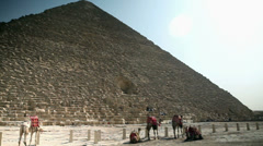 Wide shot panning of pyramid and tourists around Stock Footage