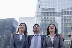 Portrait of smiling business people in a row outdoors, Beijing Stock Photos