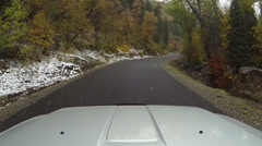 Vehicle hood autumn colors snow storm POV HD 0083 Stock Footage