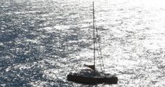 Ultra HD 4K Catamaran Sailboat in Mediterranean Sea sailing French Riviera Sun Stock Footage