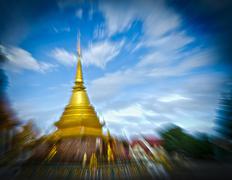 Thai golden phra tad or pagoga with blue cloudy sky Stock Photos