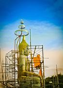 Under construction of seated buddha image in attitude of subduing mara - stock photo