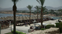 Beach with umbrellas in Sharm Stock Footage