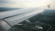 Stock Video Footage of Airoplane wing while flying over city