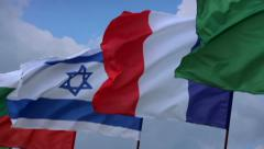 French, Israeli flags on flagstaff. France, Israel negotiations, click for HD Stock Footage