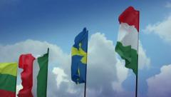 Various flags on flagpoles: Swedish, Hungarian, Italian, Romanian, click for HD Stock Footage