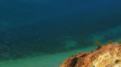 Aerial view of rocky shore and azure sea near National Park Cape Fiolent Stock Footage