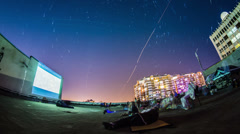 Timelapse of people watching movies in open air on the roof of the building with Stock Footage