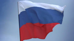 Russian national flag waving on flagpole in blue sky. Russia, click for HD Stock Footage