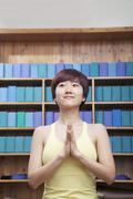 Portrait of young woman with short hair doing yoga with hands clasped together Stock Photos