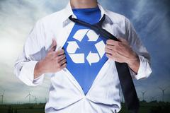 Businessman with open short revealing shirt with recycling symbol underneath Stock Photos