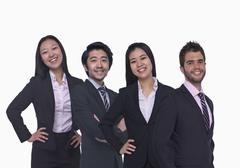 Portrait of four young business people looking at the camera, three quarter Stock Photos