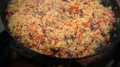 Pilaf (Plov) - Afghan, Uzbek, Tajik national cuisine main dish Stock Footage