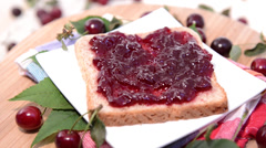 Rotating cherry Jam Sandwich Stock Footage