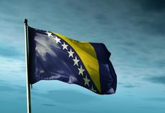 Stock Illustration of bosnia and herzegovina flag waving in the evening