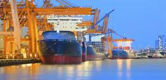 Panorama scene of ship yard with heavy crane in beautiful twilight Stock Photos