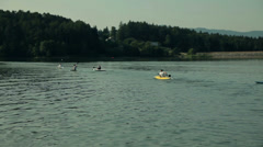 Group of people kayaking on small lake - stock footage