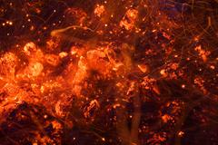Glowing coals and sparks Stock Photos
