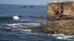 Waves break about rocks, the Atlantic Ocean at the coast of Portugal Stock Footage