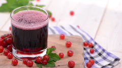 Glass with Red Currant Juice Stock Footage