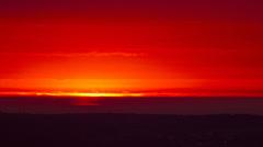 Sunrise under rainclouds - stock footage