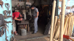 Tools section of Uzbek bazaar, blacksmith at Central Asian market, labor work Stock Footage