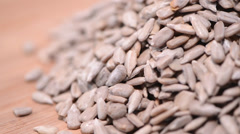 Portion of rotating Sunflower Seeds Stock Footage