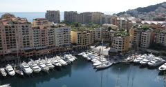 Ultra HD 4K Aerial View Skyline Iconic Fontvieille Harbor, Yachts Rich tax haven Stock Footage