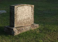 sun-cast tombstone - stock photo