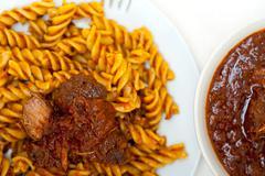 fusilli pasta with neapolitan style ragu meat sauce - stock photo