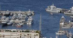 Ultra HD 4K Aerial View Harbour Monaco Port Hercules iconic catamaran boat ship Stock Footage