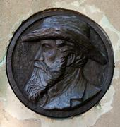 bas-relief with portrait of man - stock photo