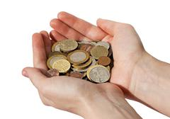 Woman's hands holding a pile of different coins Stock Photos