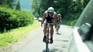 Stock Video Footage of Competitors bicycling through countryside