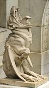 Statue of a chimera/gargoyle Stock Photos
