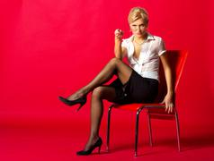 young schoolmarm sitting on the chair - stock photo