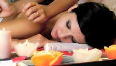 Closeup of woman relaxing receiving back massage in spa Stock Footage