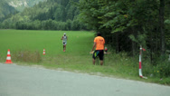 Stock Video Footage of Competitors continuing from bicycle to running competition
