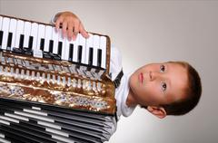 Accordion boy Stock Photos
