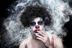 Spooky clown portrait on black background Stock Photos