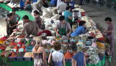 Russian girls buy spices at Chorsu bazaar in Tashkent Stock Footage