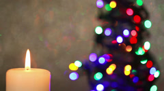 Flame of candle with christmas tree Stock Footage